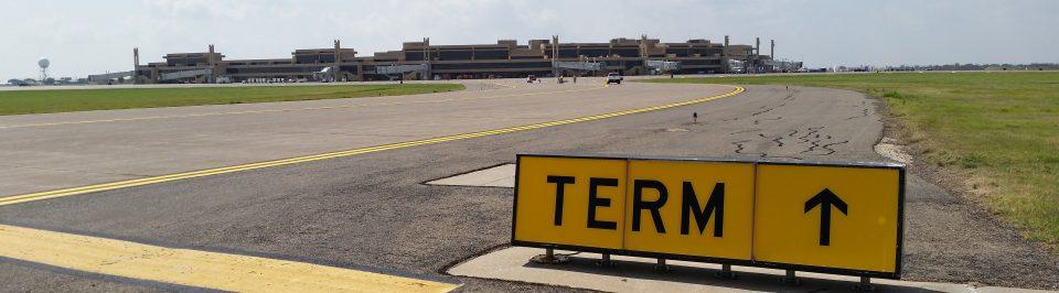Lubbock Preston Smith International Airport TERM sign pointing towards their terminals.