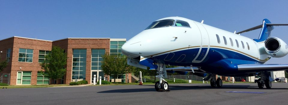 Rock Hill-York County Airport, a jet parked in front of the airport building.