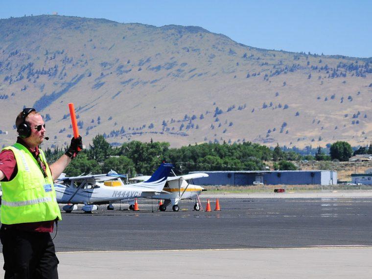 Crater Lake-Klamath Regional Airport, aircraft Marshall directing traffic.