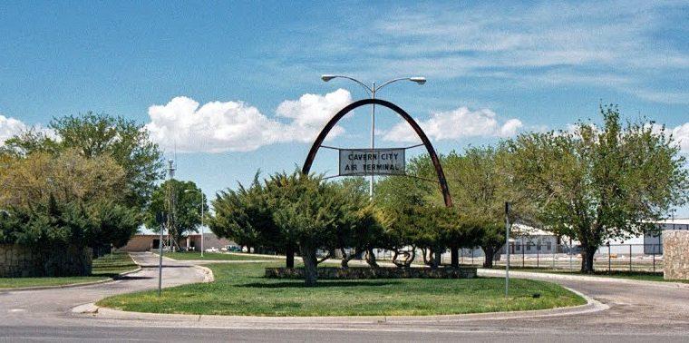 Cavern City Air Terminal entrance with their sign and blue sky.