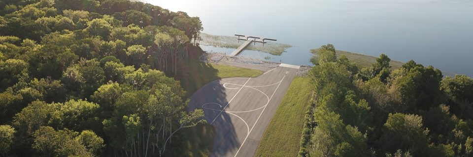 Leesburg International Airport aerial view of their new seaplane dock along the water.
