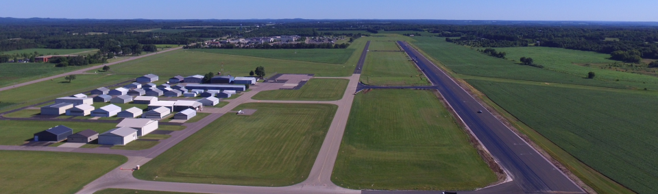 Baraboo-Wisconsin Dells Airport aerial view of runway and buildings.
