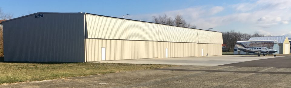 Joseph A. Hardy Connellville Airport hangar and plane.