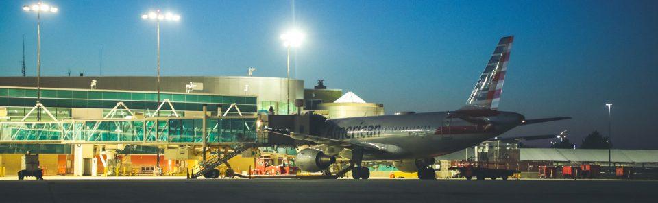 Rick Husband Amarillo International Airport plane at night with airport lights on.