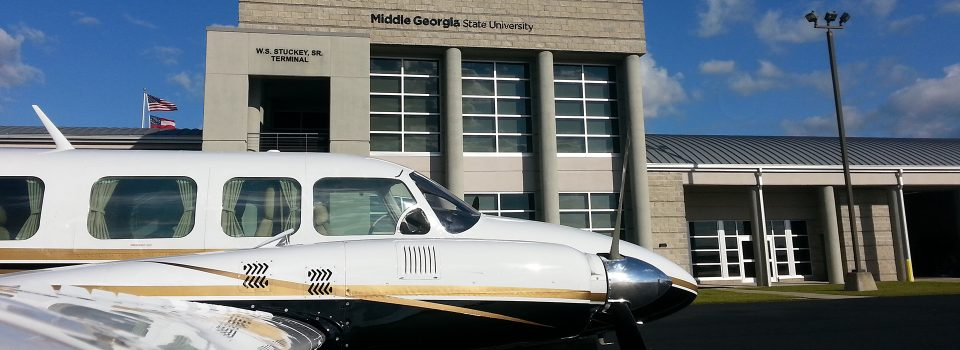 """The Heart of Georgia Regional Airport is located three miles east of the City of Eastman in South Central Georgia, and services general aviation air traffic from all over the southeast United States. The Airport was originally built by the State of Georgia for the Stuckey's Corporation to support its business operations. """"Mr. W.S. Stuckey, who started the candy company here in Eastman, Georgia, selling pecan log rolls by the side of the road, kept expanding and started putting stores all up and down the Interstate,"""" explains Airport Manager, Jeff Fordham. """"They had a Piper Aztec, and their airstrip was not long enough, so they came out here and built the Airport because they needed a place to land their bigger planes."""" When the facility was officially dedicated in December 1966, then Governor Carl Sanders hailed the $232,000 Eastman-Dodge County Airport as """"the first community airport in Georgia that we have built specifically to accommodate the modern business jet airplanes that are becoming so important in one industry after another."""" Today, the Heart of Georgia Regional Airport is owned and operated by Heart of Georgia Regional Airport Authority and is overseen by a seven-member Board of Directors, made up of two members from the Eastman City Council, two members from the Dodge County Board Commissioners Office – one is a sitting board member from each of those, and one is an at-large appointment - and two members from the Dodge County-Eastman Development Authority – one is a board member, one is an at-large appointment. The seventh member is appointed by the Georgia House of Representatives. The Airport's original 4,500-ft. runway was lengthened to 6,506 feet in 2004, and equipped with a precision instrument landing system and a landing capacity of 100,000 pounds. A new terminal and tower were completed in 2005. The Airport supports between 300-400 operations per day, comprised of general aviation, corporate, military, flight training, customs and border patrol,"""
