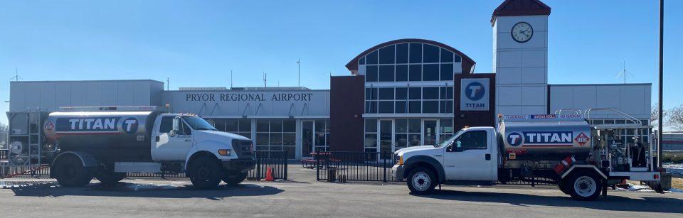 Pryor Field Regional Airport building and service trucks